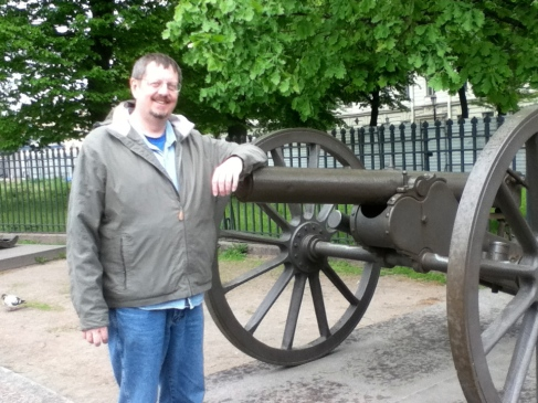 JCF poses with a cannon at Trinity Cathedral, St. Petersburg, Russia